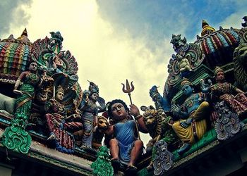 Mariamman (sitting in the middle)