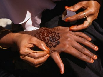 Henna tattoos being applied