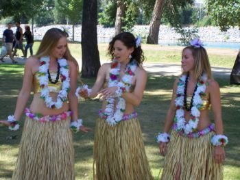 Three women wearing lei